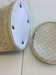 louis vuitton purse repair after